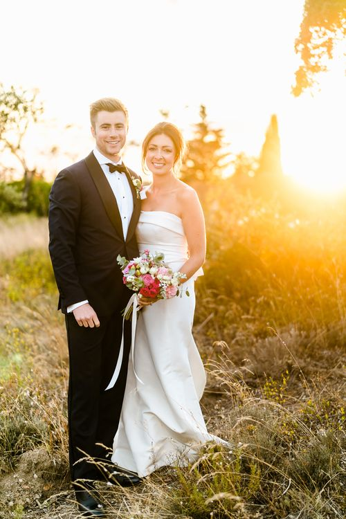 Golden Hour | Bride in  Carolina Herrera Gown | Groom in Navy Edit Suits Tuxedo | Luxe Pink & White Destination Wedding at La Bastide de Gordes in Provence, France, Styled by Haute Wedding | John Barwood Photography | Motion Craft Creative