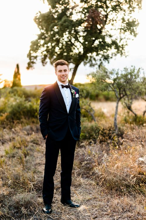 Groom in Navy Edit Suits Tuxedo | Luxe Pink & White Destination Wedding at La Bastide de Gordes in Provence, France, Styled by Haute Wedding | John Barwood Photography | Motion Craft Creative