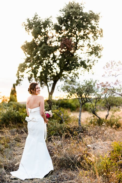 Bride in  Strapless Carolina Herrera Gown | Luxe Pink & White Destination Wedding at La Bastide de Gordes in Provence, France, Styled by Haute Wedding | John Barwood Photography | Motion Craft Creative