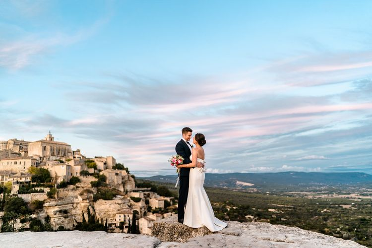 Bride in  Carolina Herrera Gown | Groom in Navy Edit Suits Tuxedo | Luxe Pink & White Destination Wedding at La Bastide de Gordes in Provence, France, Styled by Haute Wedding | John Barwood Photography | Motion Craft Creative