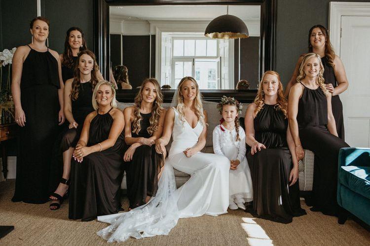 Bridal party in black bridesmaid dresses