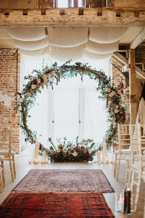 Floral moon gate for wedding ceremony