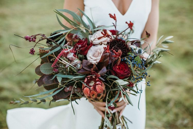 Red flower and foliage bouquet for bride to match supermarket wedding cake floral decor