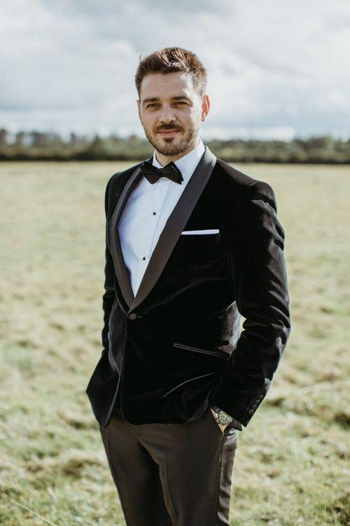 Groom in velvet tuxedo
