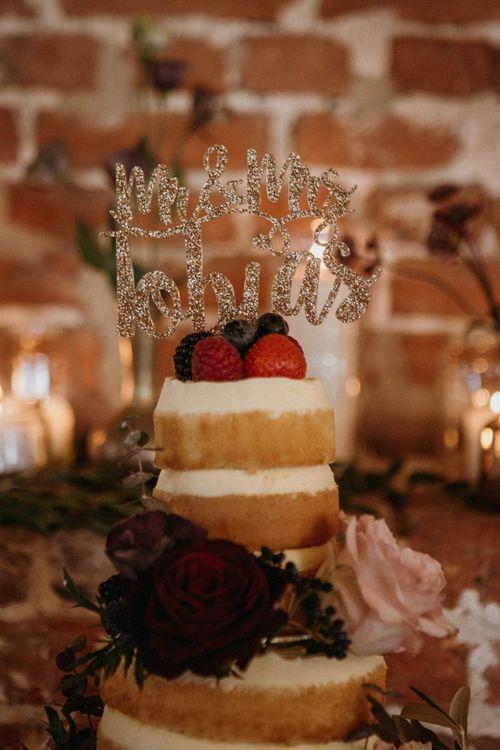 Personalised cake topper on supermarket wedding cake