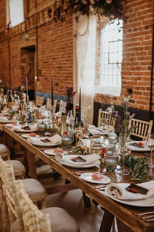 Wedding breakfast table decor with flowers and rustic elements