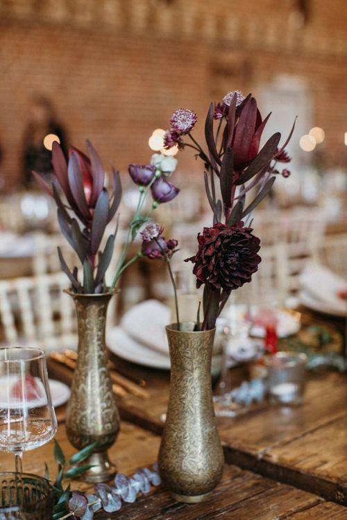 Deep red wedding flowers to match supermarket wedding cake
