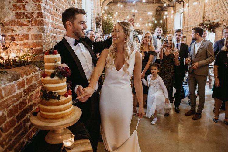 Bride and groom cut the supermarket wedding cake