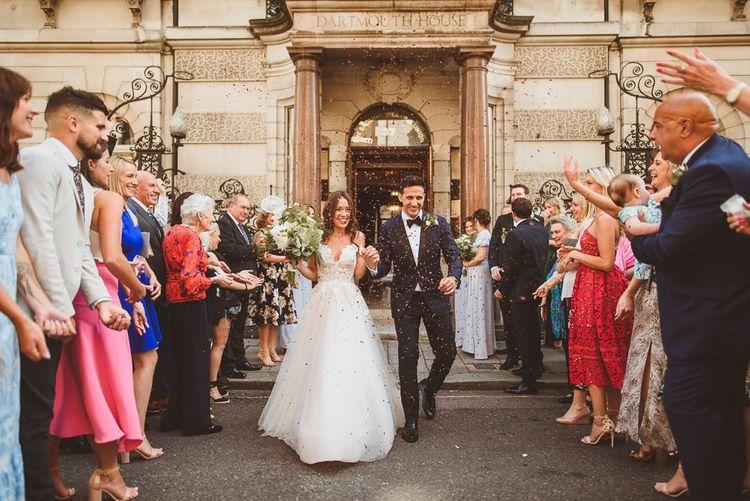 Confetti shot outside of Dartmouth House with bride wearing beautiful Martina Liana dress