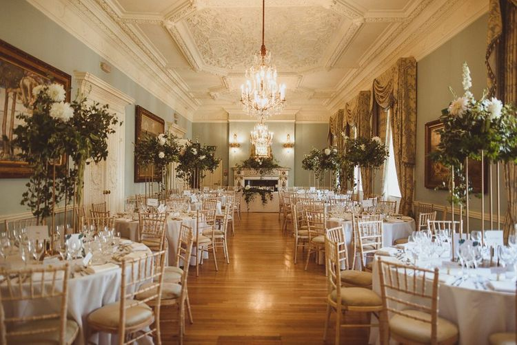 Summer London wedding at Dartmouth House with tall white floral centrepieces