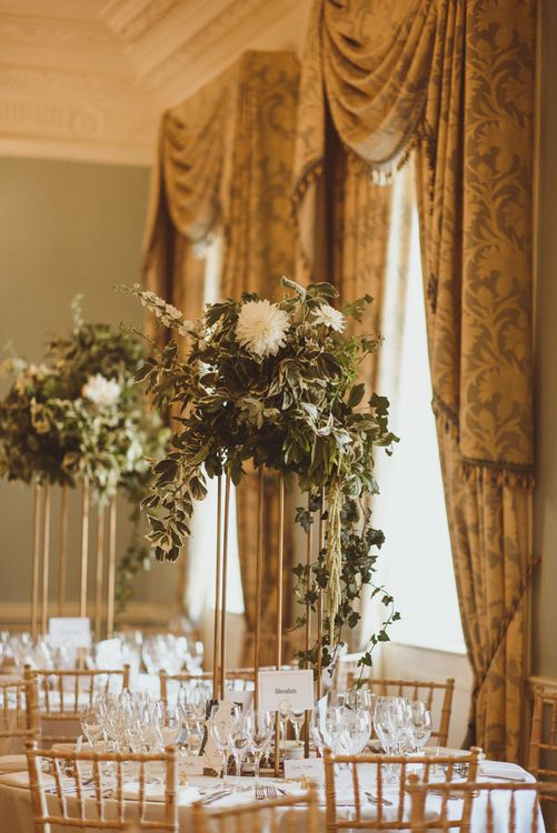 White flower and foliage table arrangements  at London celebration with botanical and art deco styling