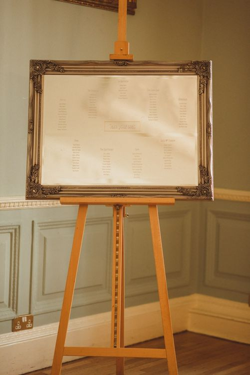 Antique style frame table plan at London reception