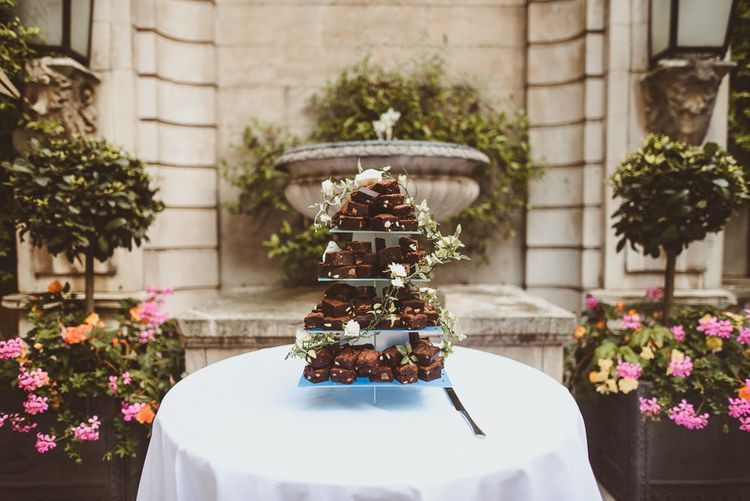 Homemade brownie tier wedding cake at summer reception in London