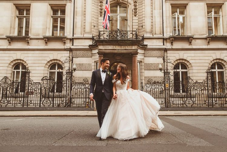 Bride and groom steal a moment wearing Martina Liana dress at Dartmouth House in London