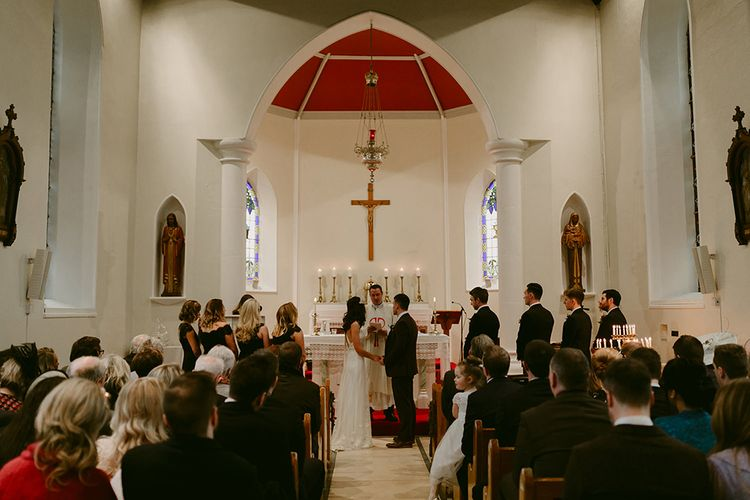 Church Wedding Ceremony with Bride in Halfpenny London Juniper Dress & Lilly Skirt and Luna Bea Headdress with Groom in Brown Wool Suit