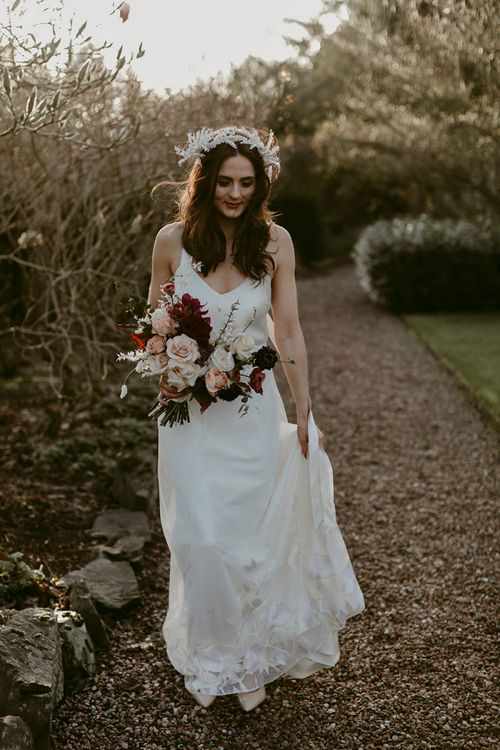 Bride in Halfpenny London Juniper Dress & Lilly Skirt and Luna Bea Headdress Holding a Deep Red and Blush Pink Rose Wedding Bouquet