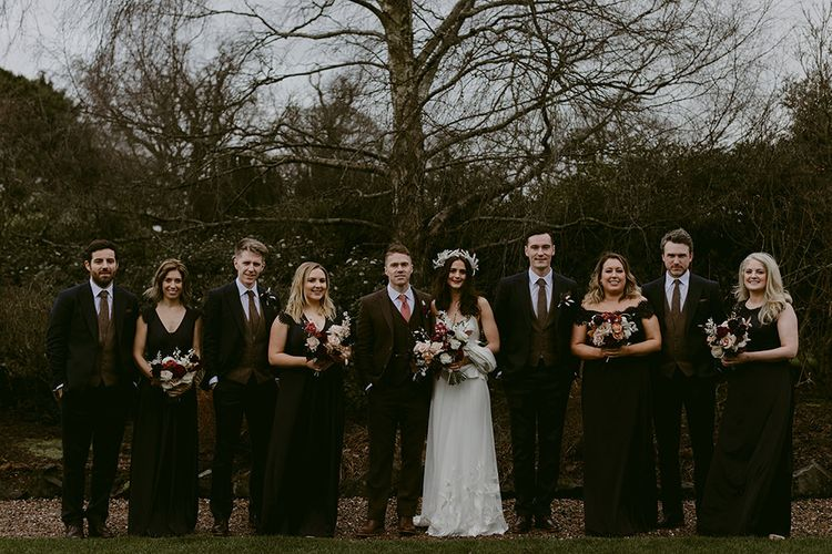 Wedding Party Portrait with Bridesmaids in Black Monsoon Dresses, Bride in Halfpenny London Juniper Dress & Lilly Skirt and Luna Bea Headdress and Groom and Groomsmen Portrait in Wool Suits