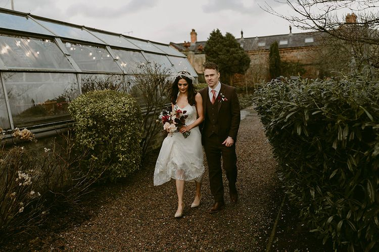 Bride in Halfpenny London Juniper Dress & Lilly Skirt and Luna Bea Headdress with Groom in Brown Wool Suit