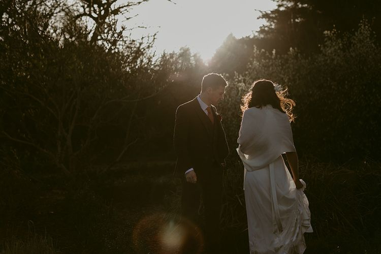 Sun Spray Portrait with Bride in Halfpenny London Juniper Dress & Lilly Skirt and Luna Bea Headdress with Groom in Brown Wool Suit