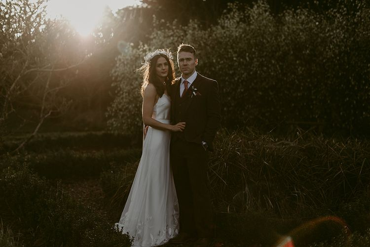Sunset Portrait with Bride in Halfpenny London Juniper Dress & Lilly Skirt and Luna Bea Headdress with Groom in Brown Wool Suit