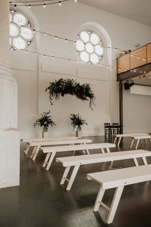Minimalist Ceremony Room with Fairy Lights, Greenery Installation and Benches