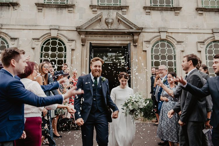 Confetti Moment with Bride in Homemade Wedding Dress and Groom in Reiss Suit