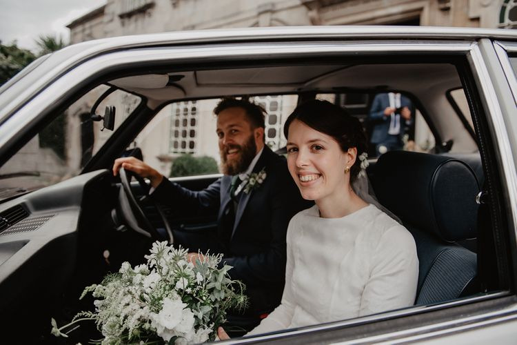 Bride and Groom Driving Off in Vintage BMW Wedding Car