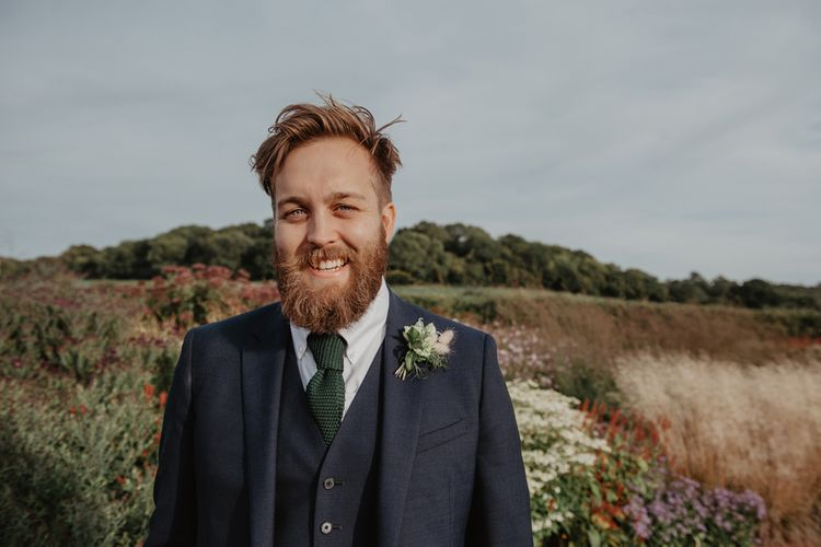 Bearded Groom in Three-Piece Navy Reiss Suit with Green Waffle Tie