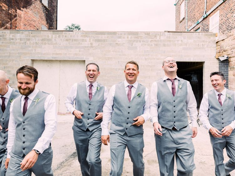 Groom and groomsmen in waistcoat and pink ties