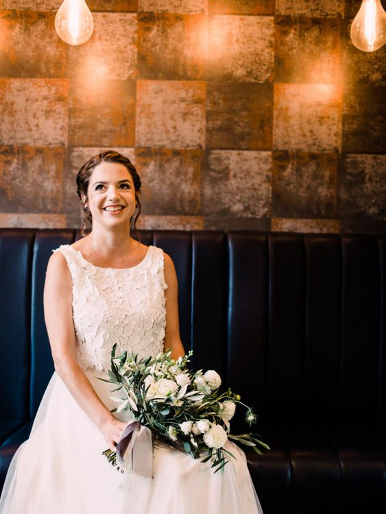 Bride looks stunning in bridal two piece and white bouquet