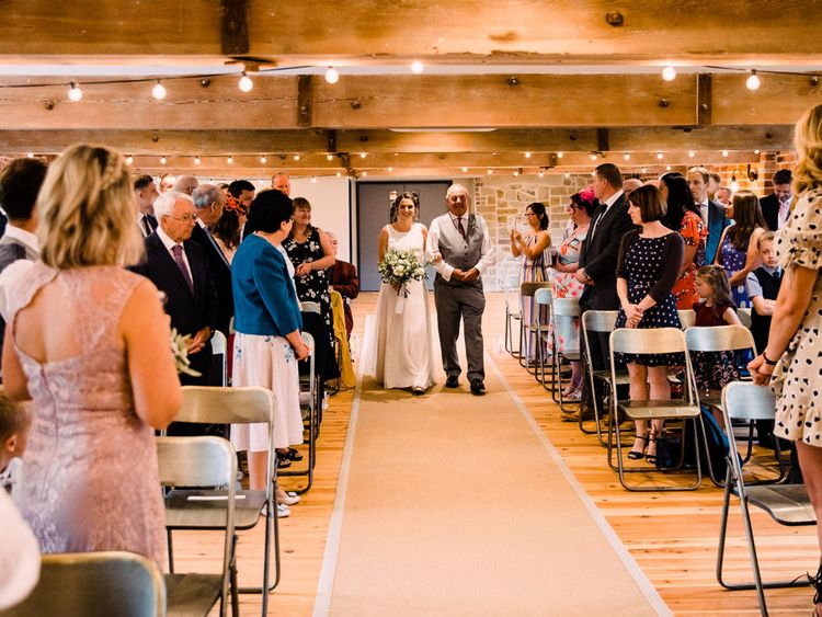 Bride walks down the aisle at Haarlem Mill wedding