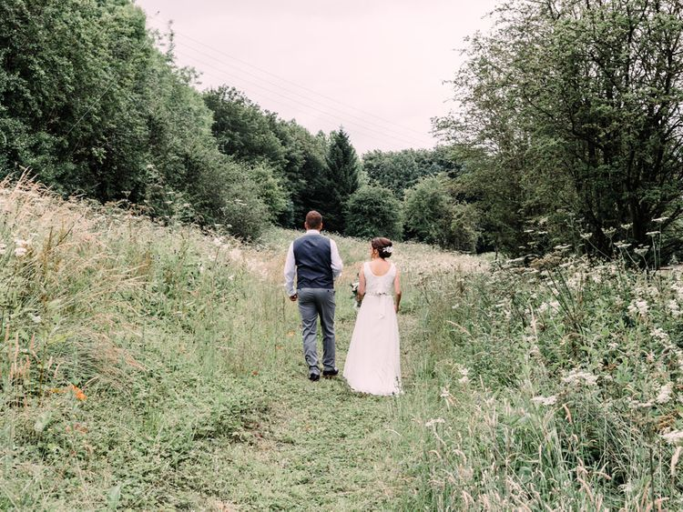 Bride and groom stroll the Haarlem Mill wedding venue grounds