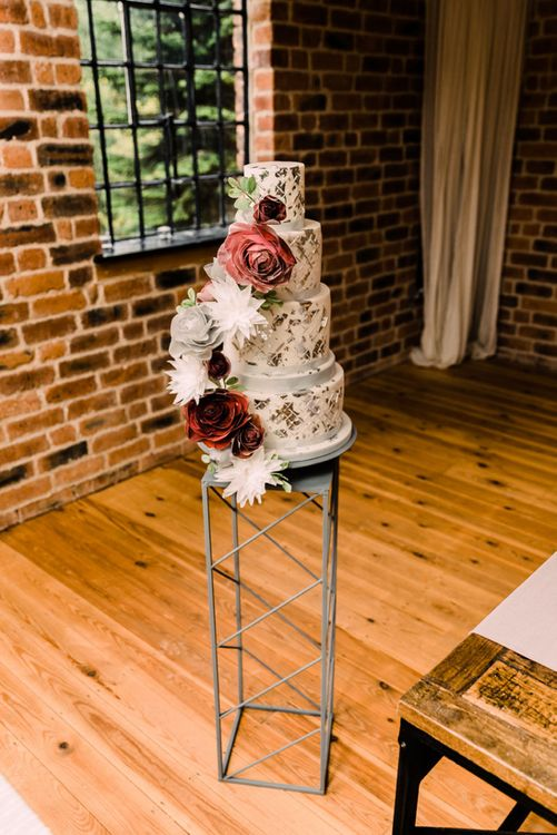 Stunning wedding cake with large flower decor