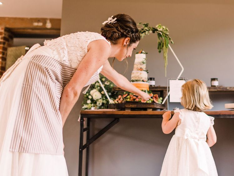 Bride shows niece the cheese tower