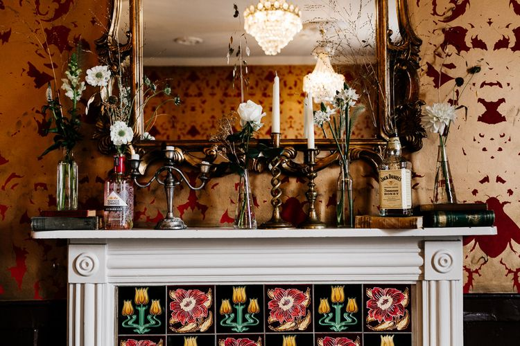 Flower Filled Mantle Piece Wedding Decor | Quirky Pub Wedding at The Bell in Ticehurst East Sussex | Epic Love Story Photography