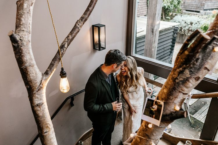Neon Light Sign | Bride in Charlie Brear Delancey Gown & Belt | Groom in Hugo Boss Suit | Quirky Pub Wedding at The Bell in Ticehurst East Sussex | Epic Love Story Photography