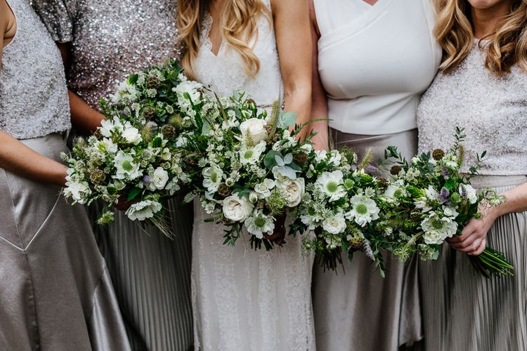 Bridal Party Bouquets | Bridesmaids in Metallic Silver Skirts & Sequin Tops | Bride in Charlie Brear Delancey Gown & Belt | Groom in Hugo Boss Suit | Quirky Pub Wedding at The Bell in Ticehurst East Sussex | Epic Love Story Photography