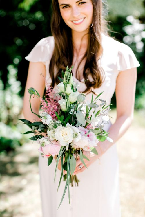 Bridesmaid with Pink, White and Green Bouquet