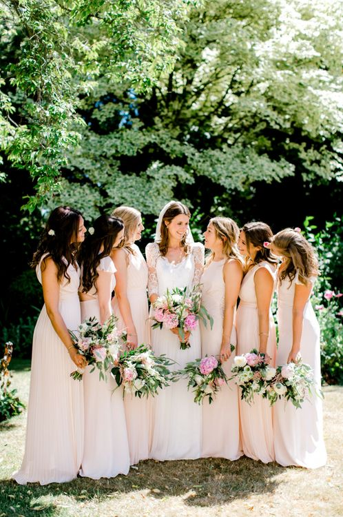 Bridal Party Portrait with Bridesmaids in Pink TFNC and Maids to Measure Dresses and Bride in Dana Bolton Wedding Dress