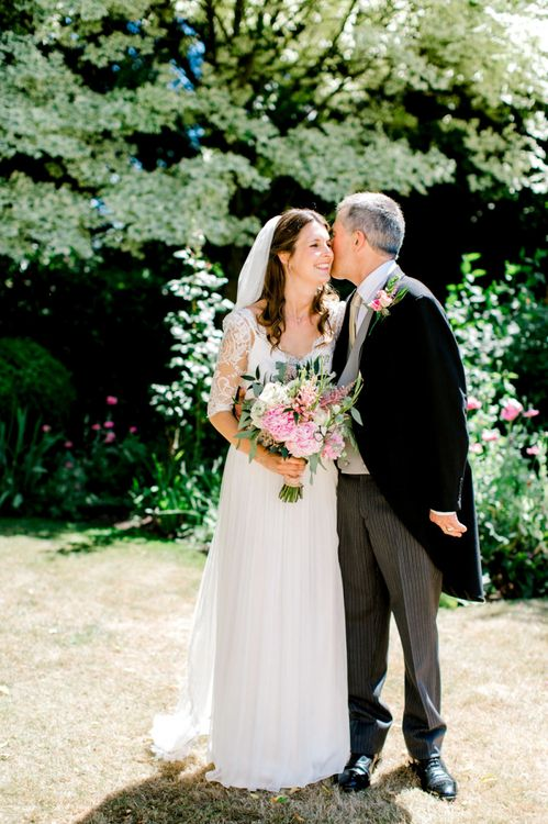 Father of The Bride in Traditional Morning Suit and Bride in Dana Bolton Wedding Dress with Lace Bodice