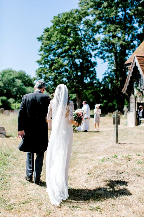 Church Wedding Ceremony Bridal Entrance in Dana Bolton Wedding Dress and Cathedral Length Veil