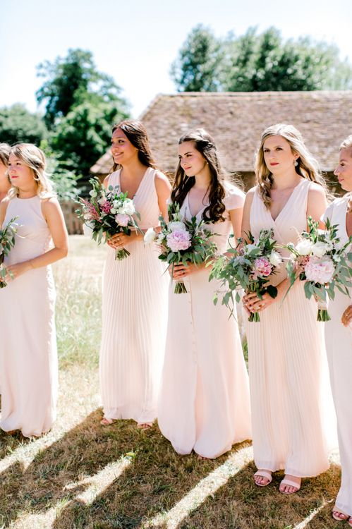 Bridesmaids in Pastel Pink TFNC and Maids To Measure Dresses