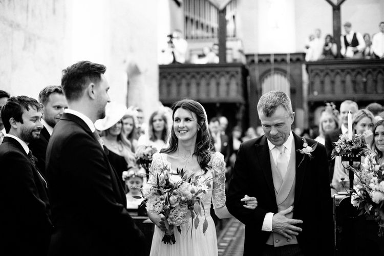 Church Wedding Ceremony Bridal Entrance in Dana Bolton Wedding Dress and Groom in Morning Suit