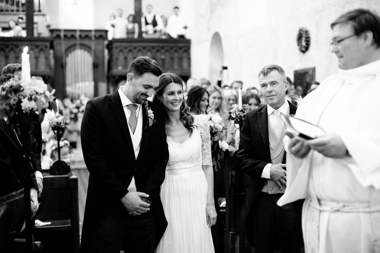 Church Wedding Ceremony with Bride in Dana Bolton Wedding Dress and Groom in Morning Suit