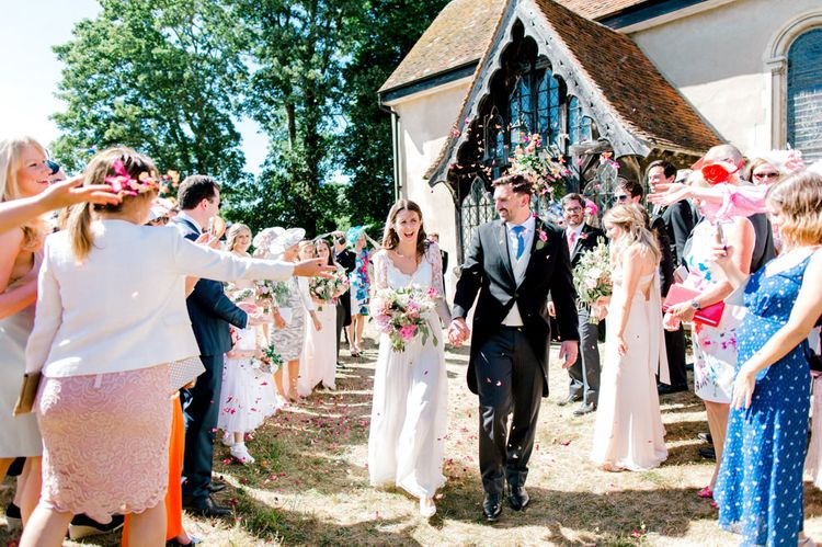 Church Courtyard Confetti Moment with Bride in Dana Bolton Wedding Dress and Groom in Morning Suit