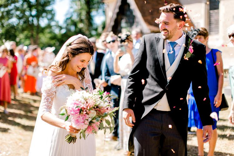 Confetti Moment with Bride in Dana Bolton Wedding Dress and Groom in Morning Suit