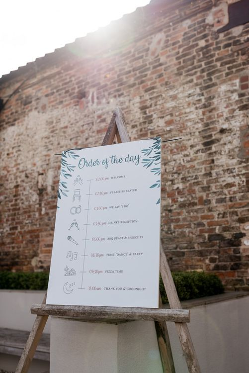 Order of The Day Wedding Sign on a Wooden Easel