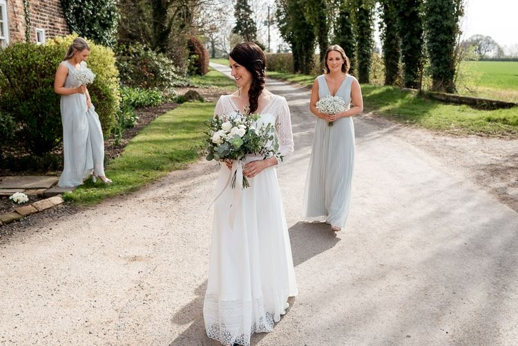 Bridal Party with Bride in Lace Rembo Styling Wedding Dress and Bridesmaids in Light Green Dresses