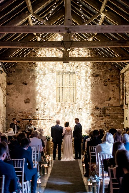 Barn Wedding Ceremony at The Normans with String Light Wedding Decor