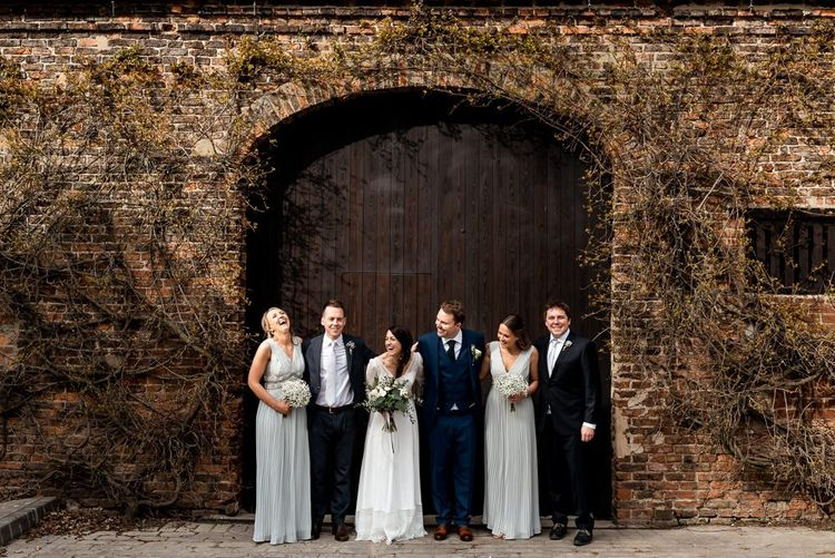 Wedding Party Portrait with Bride in Rembo Styling Wedding Dress, Bridesmaids in Pale Blue Dresses and Groomsmen in Navy Suits